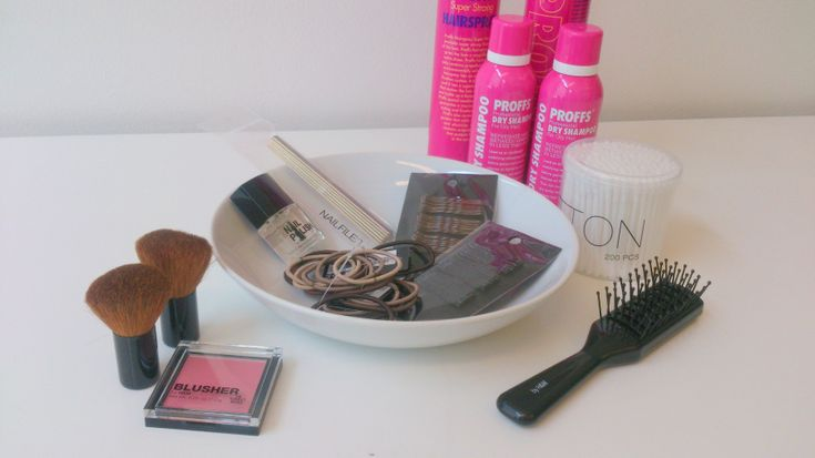 Touch up station for female wedding guests: hairspray, dry shampoo, clear nail polish, hair pins, q-tips and more.