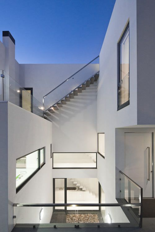 Portuguese design firm [i]da Arquitectos designed this home that I think would also be suitable for our Skim Milk column – a classic white box.