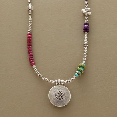 """A stream of sterling silver interspersed with coral, turquoise, rubies, gaspeite and chrysoprase beads is home to a lotus charm. Handmade in USA. Approx. 16"""" to 17-1/2""""L."""