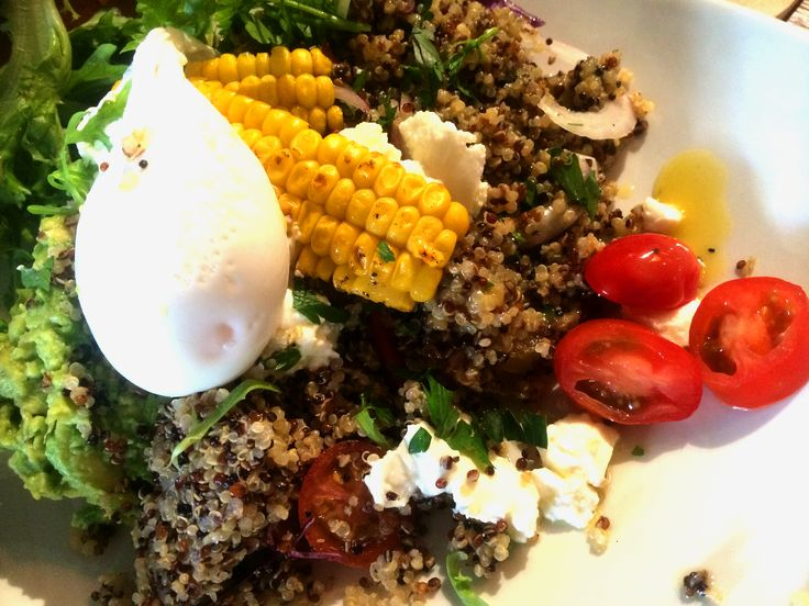 Crushed avocado , tomato, feta, quinoa herb tabbouleh, poached egg at Dachshund Coffee in Hunters Hill