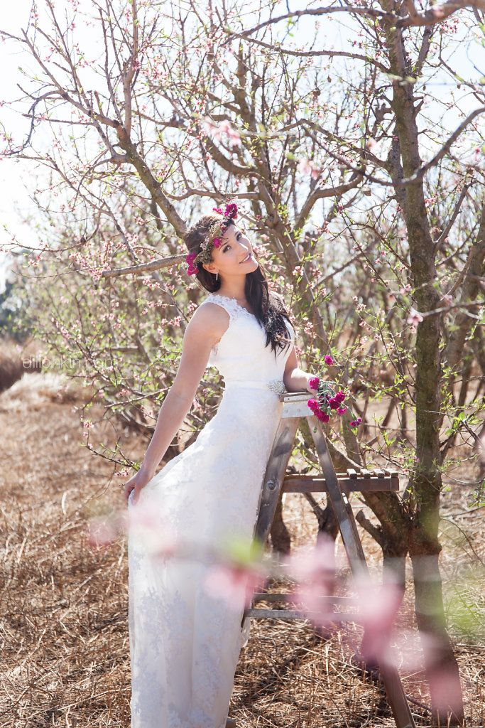 Probably one of my favourite shots from the Bales and blossoms shoot we did last year.   Pretty pink blossoms, a gorgeous bride and some fields.  You can find more here http://dillonkin.com/albums/spring-inspired-bridal-styled-shoot/