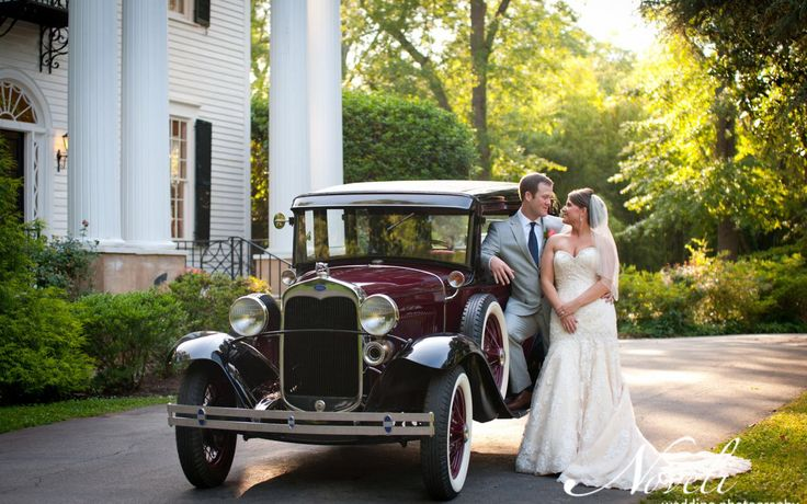 Antique cars at wedding make awesome props!