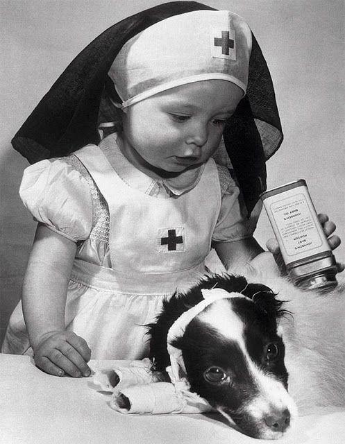 Vintage photo of child playing at being a nurse. –undated -- 65 Photos of Vintage Nurses—Nurses Through the Centuries #nursebuff #nurses #vintage