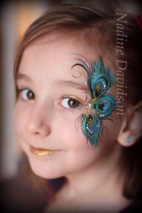 Peacock Feather Face Painting by Nadine Davidson | Nadine's Dreams Face Painting #peacock #facepaint #girlfaepainting #facepainting #peacockfacepaint #featherfacepaint #peacockfeathers