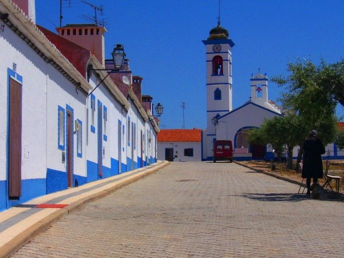 I love the calm and warm Alentejo landscape.Its low houses and painted white and blue.