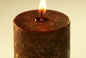 Brown candles -- used for healing animals, home issues, locating lost objects, grounding, finding common sense, and averting crises,