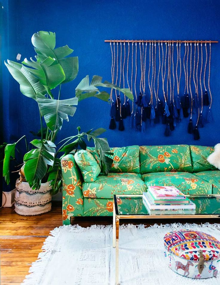 "After visiting Casa Azul in Mexico City — the cobalt blue home Frida Kahlo and Diego Rivera shared — Holley was inspired to hunt down a similar shade for her own eclectic living room. In the end, Benjamin Moore ""Blueberry Hill"" fit the bill perfectly. Like the rest of her home, this spot is outfitted in secondhand finds."