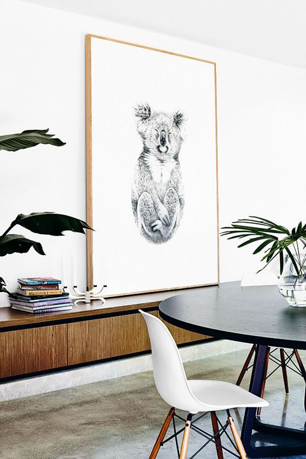 Eames chairs, a giant kaola and floating credenza--image via A House in the Hills