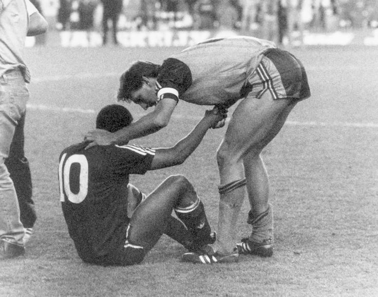 Arsenal win the championship at Anfield. Tony Adams always the main man was first to offer his hand to a fallen and beaten John Barnes .