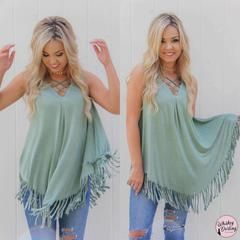 How gorgeous is this fringe tank with lace up detail?! We love how easy this top is. Throw it on with your favorite skinny jeans and you are ready to go!