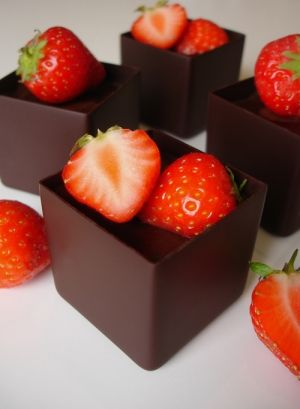 These delicate little chocolate cups are made with Michel Cluizel 72% dark chocolate. They can be filled with any flavour of cake and layered with fillings from my selection. Great topped off with fresh berries. These bite-sized cubes are 4cm square and perfect served as petit fours or a couple for dessert.