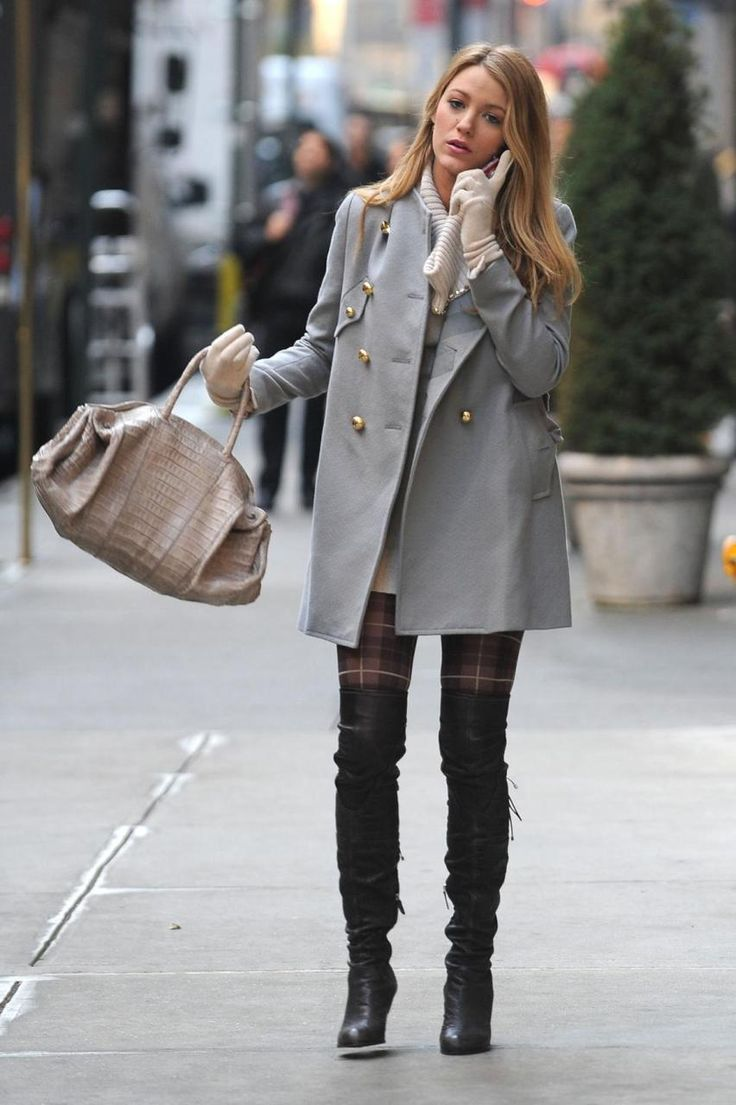 Light blue coat over white sweater dress and black boots with beige bag and white gloves.  Gorgeous!  From Gossip Girl.