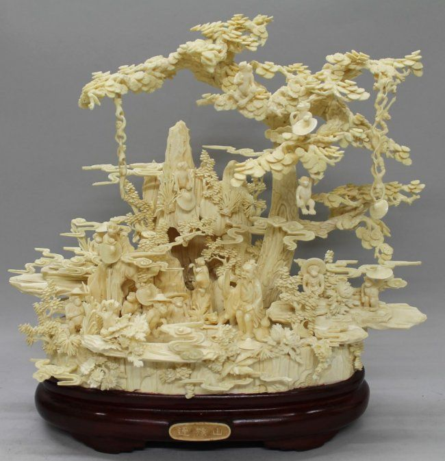 IVORY  CARVING OF A TREE WITH MONKEYS