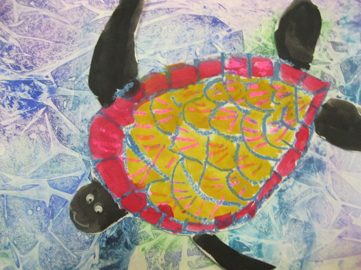 Turtles swimming. We used gladwrap on tempera paint backgrounds to create watery image. turtles were created using crayon and wash techniques. Turtles were cut out and attached to background using thick double sided tape.