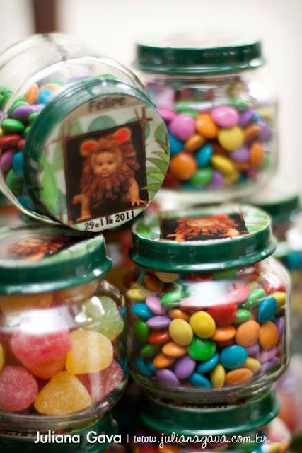 Fill baby food jars with candy and give them out at his first birthday party. Love this recycle idea!
