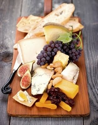 Grapes, apples, nuts, jam, french bread, brie, swiss, havarti, salami, prosciutto