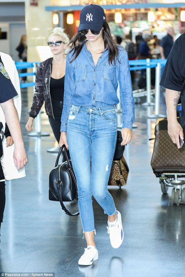Casual customer: Kendall went for a double denim look, tucking her jean blouse into her distressed trousers