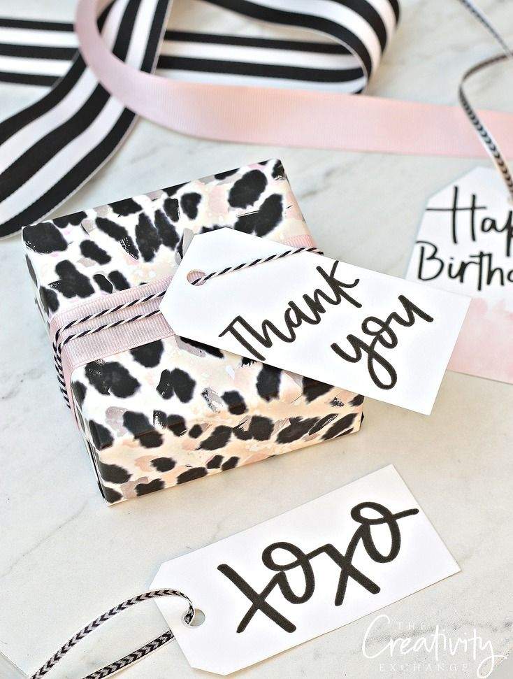 Free printable hand lettered gift tags and printable leopard print gift wrap in several different colors.