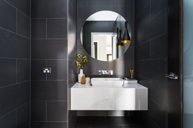 POWDER ROOM: A modern architectural style with strong bold charcoal tones. A touch of classism is created through the use of a marble bench bringing the Classic style of the Georgian façade into the home. Visit High Street on our Lookbook here: http://www.metricon.com.au/get-inspired/lookbook/high-street