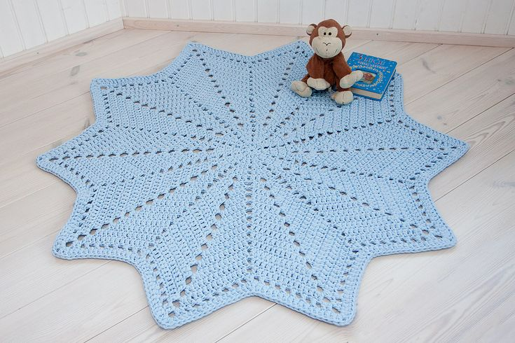 Light blue crochet doily rug with a diameter of 135 cm / 53 inches. It is made of cotton t-shirt yarn