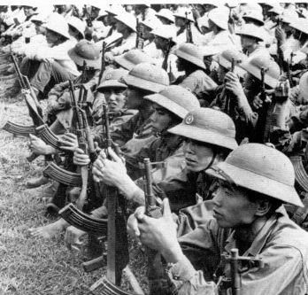 Soldiers of the North Vietnamese Army (NVA), these were mostly drafted, well armed, poorly trained, well led, battle shy, and reluctant  soldiers from North Vietnam sitting for a group photo before heading down the Ho Chi Minh trail to get their asses handed to them during the Tet offensive.. Xin loi em nhieu lam