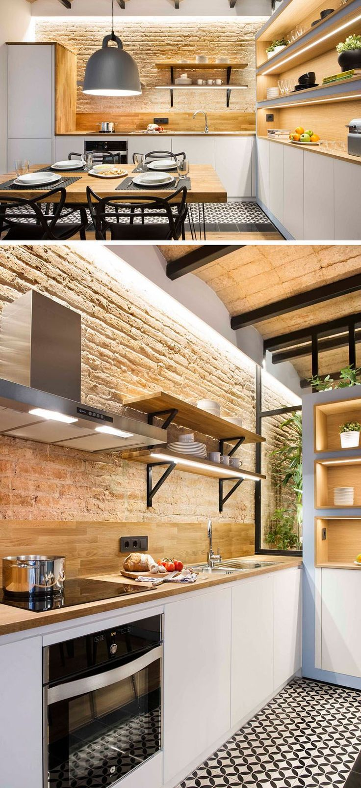 In this small modern kitchen, wood countertops and backsplash compliment the warm brick while white cabinets, stainless steel appliances, and open shelving with built in lighting help keep the space feeling bright. The combination of the new materials and the old exposed brick creates a modern feel mixed with a hint of rustic charm.