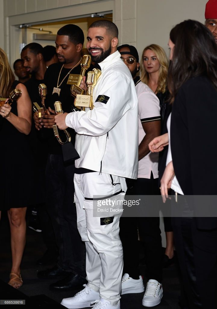 Rapper Drake poses in the press room with his awards for Top Artist, Top Male Artist, Top Billboard 200 Artist, Top Billboard 200 Album for 'Views,' Top Hot 100 Artist, Top Song Sales Artist, Top Streaming Artist, Top Streaming Song (Audio) for 'One Dance,' Top R&B Song for 'One Dance,' Top R&B Collaboration for 'One Dance,' Top Rap Artist, Top Rap Album for 'Views,' and Top Rap Tour during the 2017 Billboard Music Awards at T-Mobile Arena on May 21, 2017 in Las Vegas, Nevada.