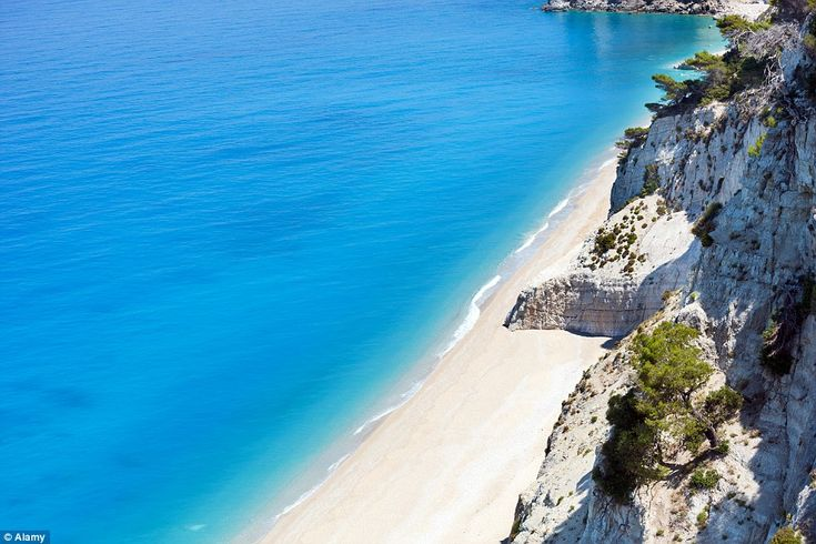 In Lefkada, Greece, the stunning Egremni Beach offers pristine sandy beaches and out-of-th...