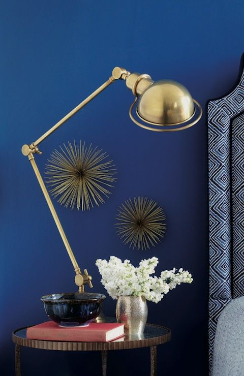 cobalt blue wall and gold accents for the master bedroom