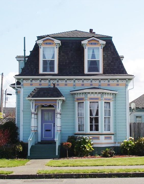 Capped with a whimsical mansard roof, this circa-1883 jewel box proves that the best things come in small packages.
