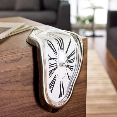 Inspired by Salvador Dalís famous surrealist painting, this clock is sure to turn a few heads and add some artistic  flair to any room.