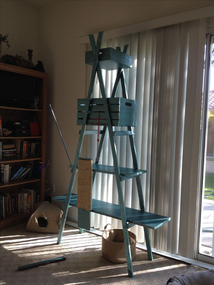 Diy cat climber. Under $25. Ladder style. Made with clearance paint and wood from Home Depot. Michaels coupons for crate and box. Left over fabric and batting from quilting projects.