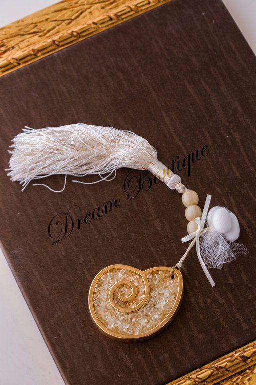 Εντυπωσιακή μπομπονιέρα γάμου επίχρυσο κοχύλι με κρυσταλλάκια