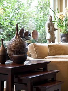 Asian /Resort Style Design, again darker furniture peices and soft neutral palette, textural natural fibres and wooden accessories.