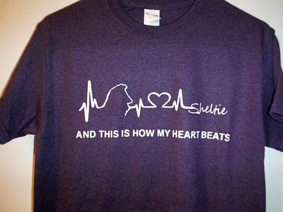 For the dedicated Sheltie lover - This Is How My Heart Beats shown with white print on an Blackberry T, it really stands out! Soft and supple these shirts offer the ideal fit.    Printed on a high quality Gildan T-shirt.   100% preshrunk cotton blend; Seamless rib at neck; Taped shoulder-to-shoulder; Double-needle stitching throughout.    The first color swatch shows Cherry Red, Heather Grey and Blackberry  The second color swatch shows Antique Sapphire, Midnight and Heather Red    Please…