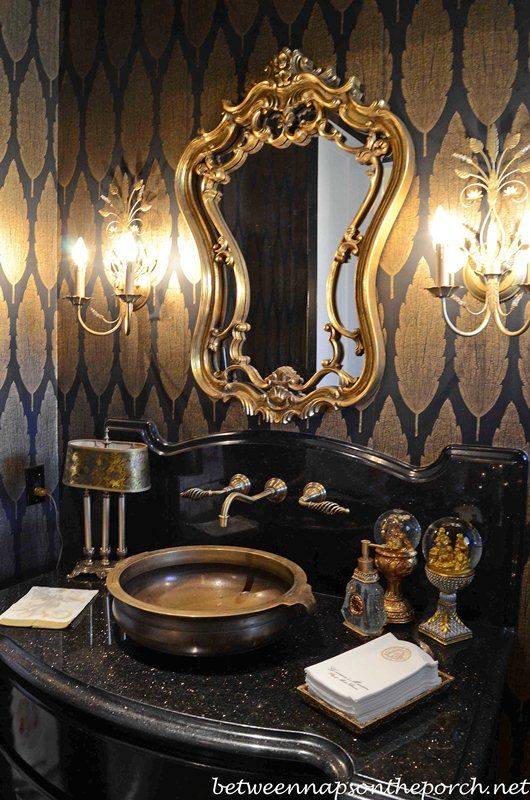 Love everything about it! Mirror, lighting, color scheme.