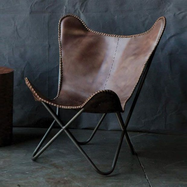 Combining metal and leather, this chair brings modern design to ancient materials. Inspired by the graceful, curving form of a paperclip, the chair provides a poised presence in any space.