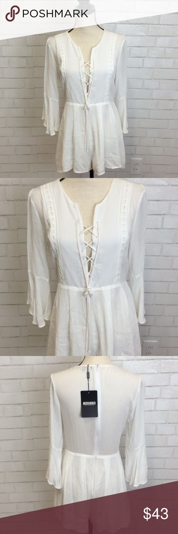 """MISGUIDED Lace-up White Bell Sleeve Romper This romper has a sexy or modest option. Lace up or keep loose! Romper has feminine lace on front and its arms. Very pretty modest bell sleeves. Size 8. 100% Polyester. Measurements: Shoulders: approximately 16"""" Top to bottom hem approximately 26"""" Sleeves reach approximately 16"""" at longest point of sleeve Missguided Pants Jumpsuits & Rompers"""
