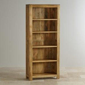 The Mantis Light Natural Solid Mango Tall Bookcase is more than just a place to keep your beloved book collection; it's an impressive piece that will make a statement in any room. Crafted from solid mango wood throughout, it features a simple yet highly effective design that accentuates the beauty of this exotic wood.