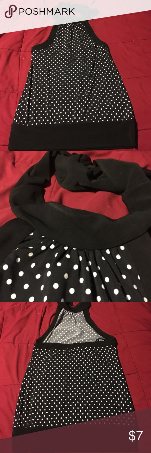 Black and white polka dot halter. Size XS Black with white polka dots. Ties around neck. Some slight discoloration around the neck. See pic. Size XS White House Black Market Tops Blouses
