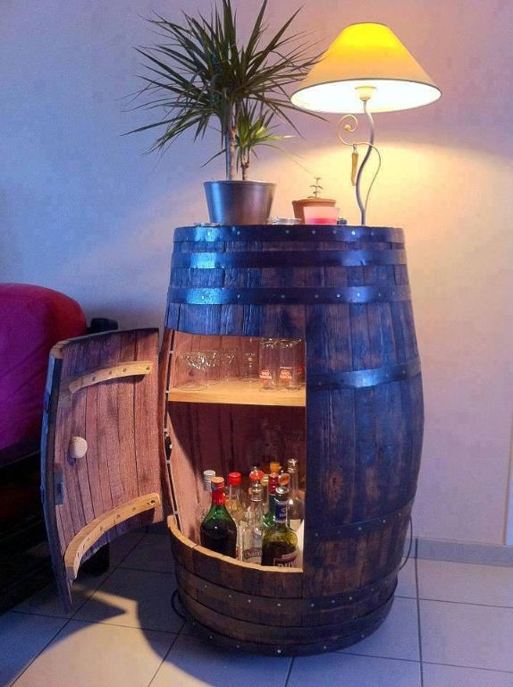Recycle an old wine barrel as a storage cabinet. [ Wainscotingamerica.com ]