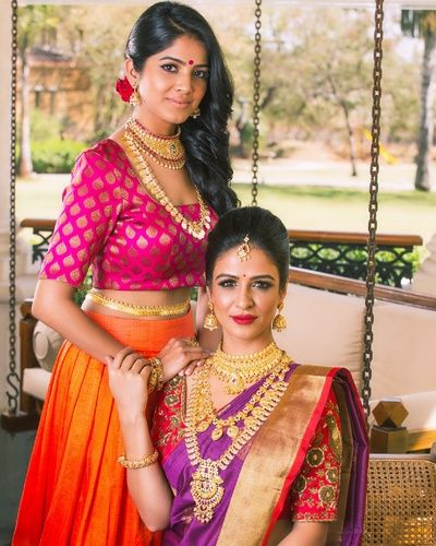 South Indian Jewlery - Bride in a Red and Purple Kanjivaram Saree with Layered Necklace, Pink and Orange Bridal Lehenga #wedmegood #indianbride #indianwedding #bridal #southindianbride #southindianwedding #jewelry #goldjewlery #saree #kanjivaram #southindianjewelry