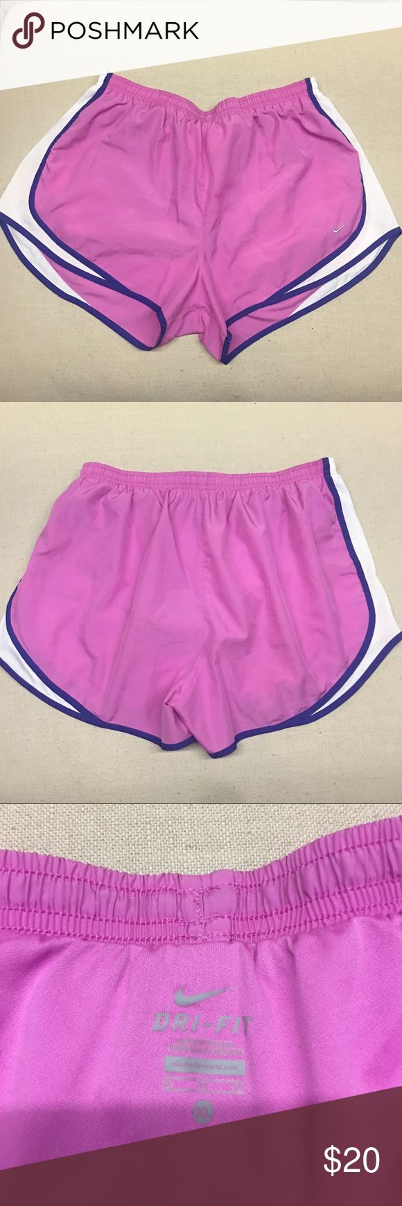 Nike Dri Fit Shorts Great condition dri fit shorts number some faint stain on the front but if I still fit into them I'd still wear them all the time. Pink with purple trip and white sides.  Nike Dri Fit Style, staple for a summer wardrobe or to start off a New Years resolution! Offers are welcomed and I love to bundle so check out the rest of my closet and no Trades or holds please. Nike Shorts