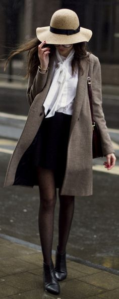 beige Zara mac coat with a white Gnossem blouse, the mini skirt from Asos and a Forever 21 floppy hat
