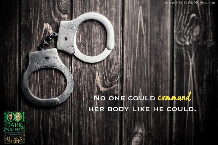 Handcuffs on wooden background
