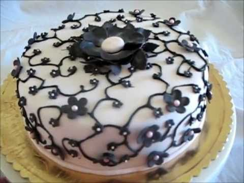 Decorating a Cake - Pink with black blossoms
