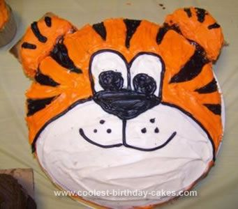 Homemade Tiger Birthday Cake: I came up with the idea for this Tiger birthday cake for my son's 1st birthday because we were planning a zoo themed party. First, I traced the pan on