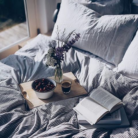 Coffee and books in bed, finally relaxing