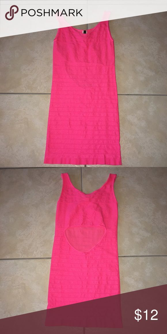 Neon pink mini dress Neon pink bandage dress that's one size fits all. Hugs curves. Never worn. I put Medium size since there is no one size option! Dresses Mini