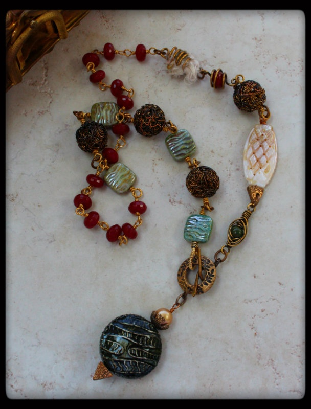 by  Lori Anderson, via www.PrettyThingsBlog.com, with pendant by Earthenwood Studio